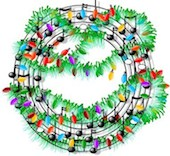 holiday wreath with music staff and notes among evergreens