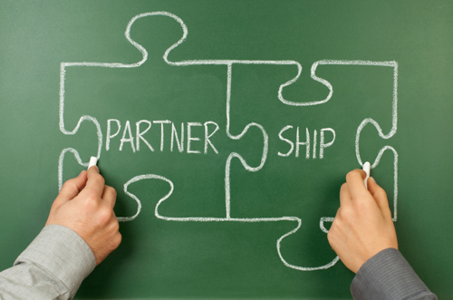 partnership written on chalkboard