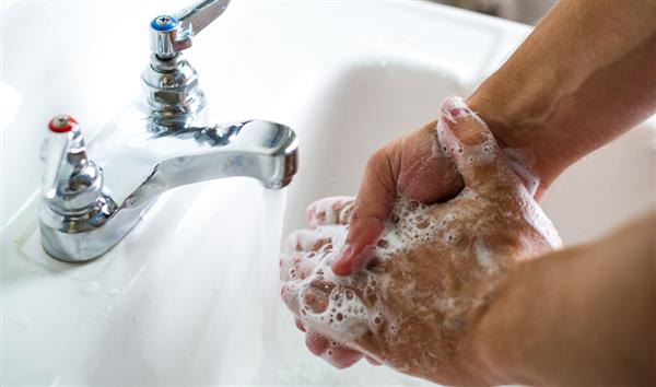 hand washing in sink with soap