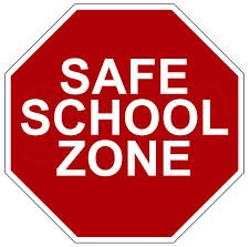 safe school zone on red stop sign.