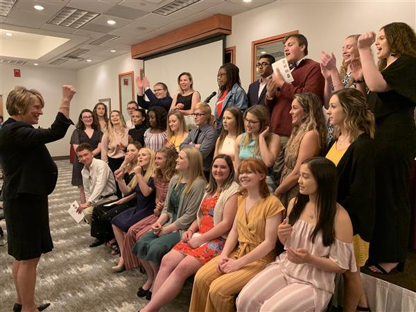 students from leadership academy pose for picture at awards dinner