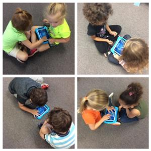 Kindergarten Students working with their partners on iPads to aurally identify high and low pitches.