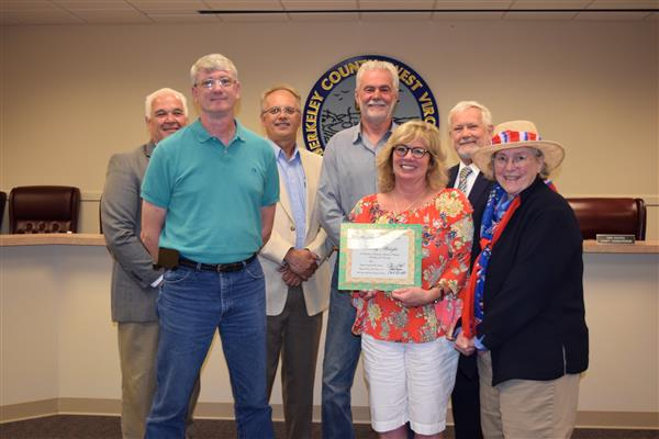Tammy Albright poses for photos with County Council in front of County Seal