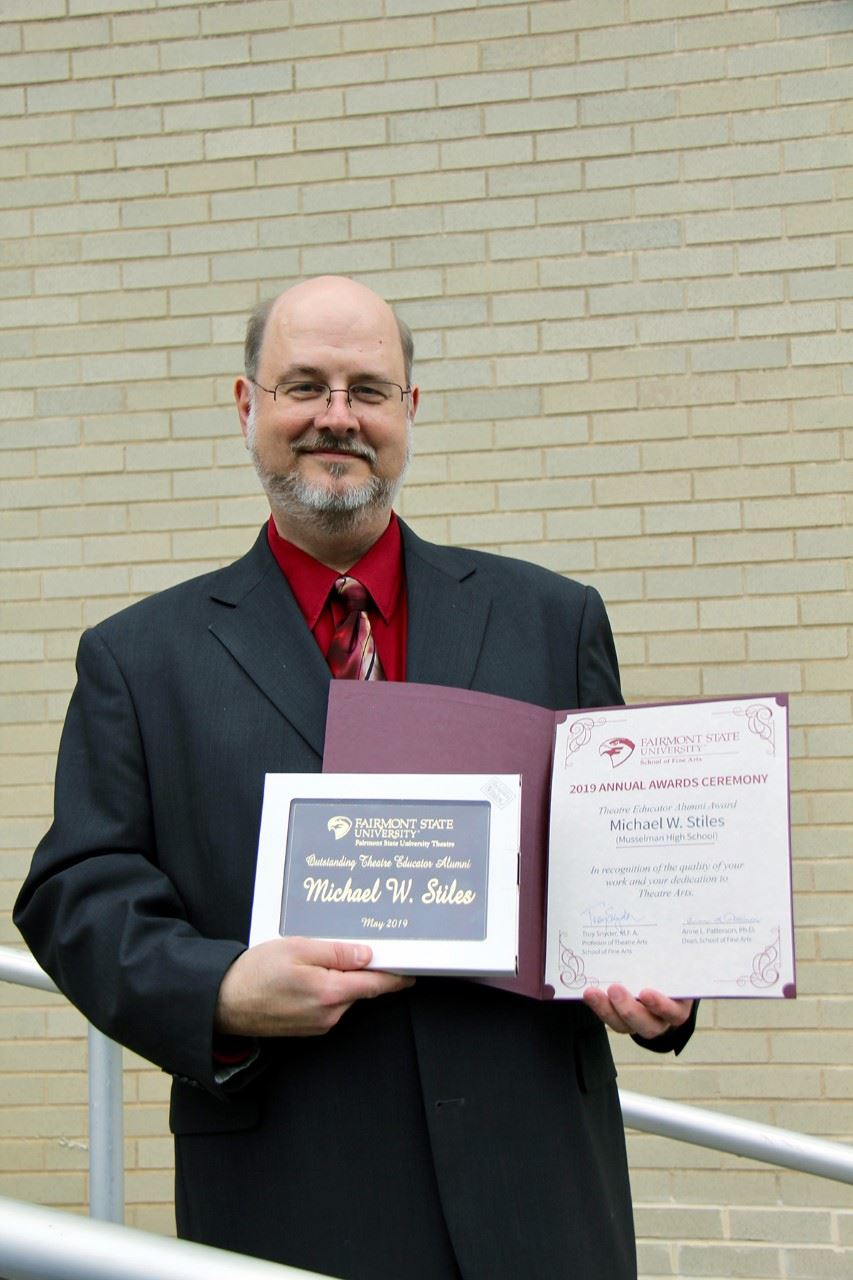 Mike Stiles poses with certificate.