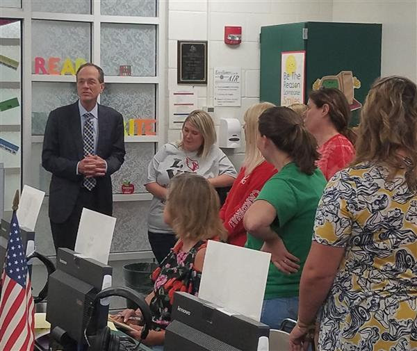 dr. murphy meets with staff at school site.