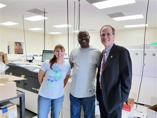 Dr. Murphy meets with Print shop staff